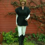 Black poncho, cream trousers