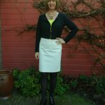 Patent leather booties, cream skirt and black cardi
