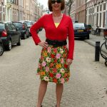 Flower skirt with red cardigan and black jacket