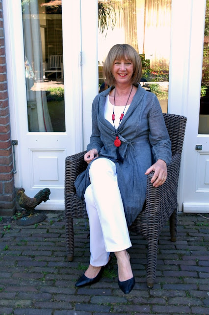 Grey tunic with white trousers