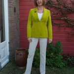 Lime green corduroy jacket and cream corduroy trousers