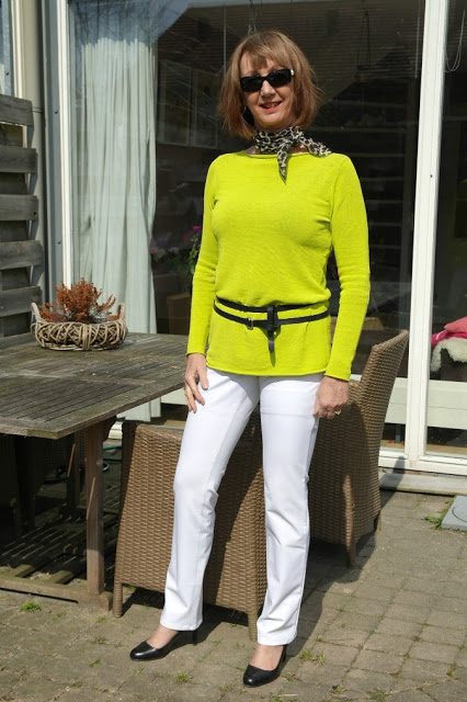 A lime sweater creates lots of combinations