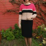 Little black dress with pink striped cardigan