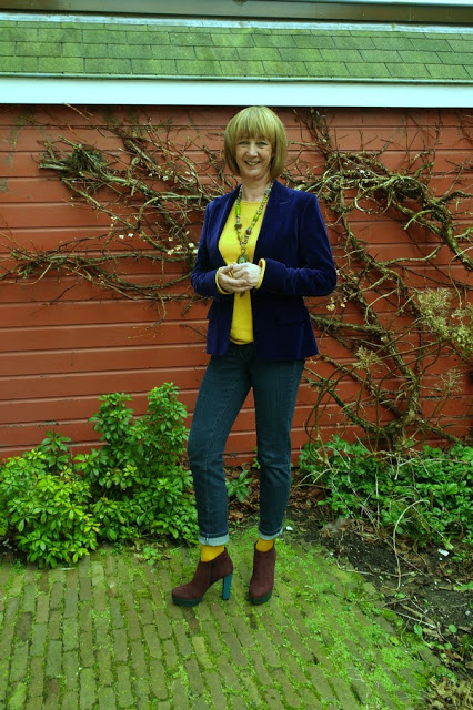 3 coloured high heeled booties and purple jacket