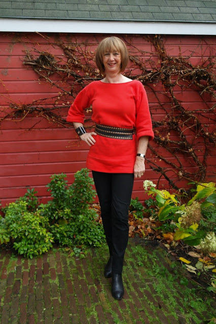 Red sweater, cute belt, black trousers