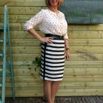 Black & white striped skirt with several tops