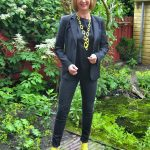 Black jacket and skinnies with yellow details