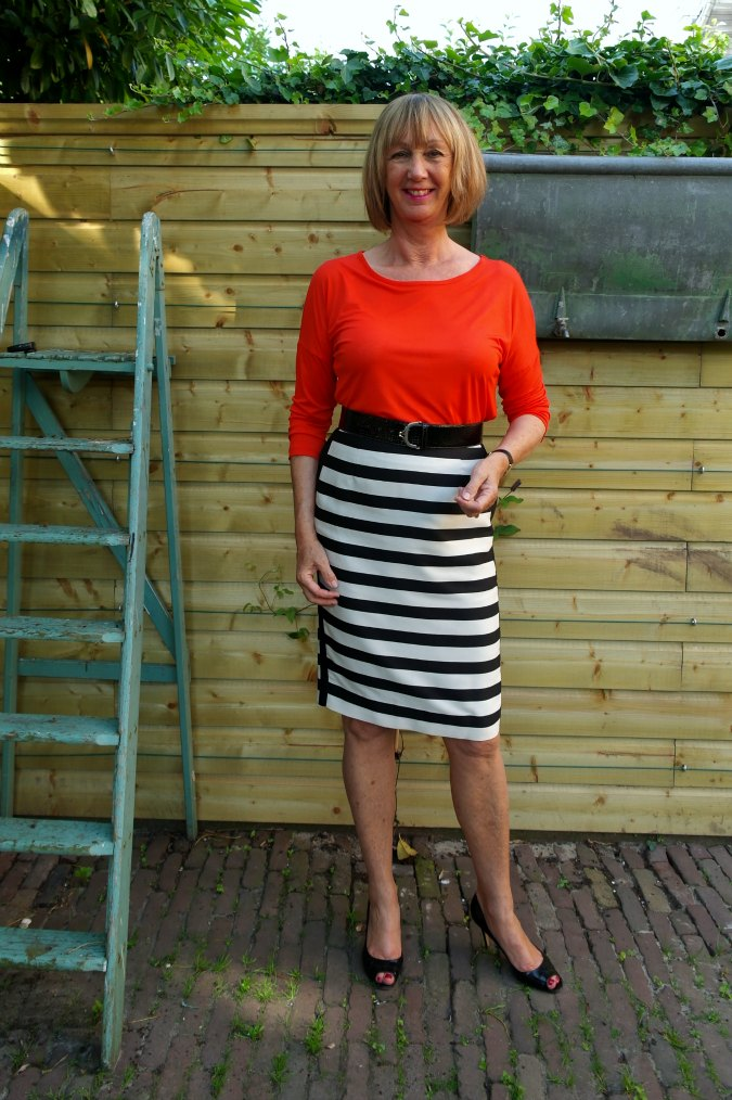 Orange shirt with B&W striped skirt 1