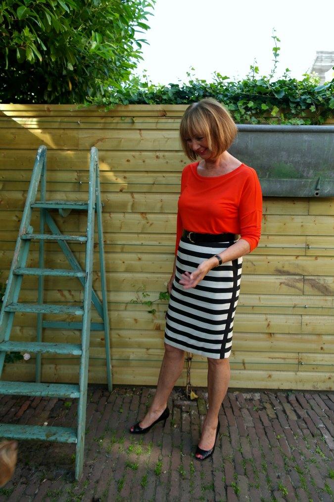 Orange shirt with B&W striped skirt 2