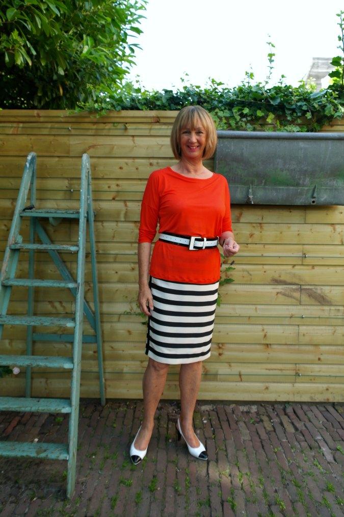 Orange shirt with B&W striped skirt 3