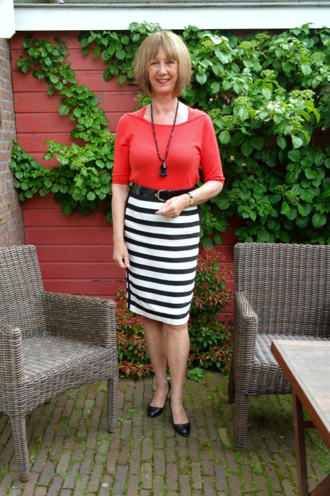 Orange top with B&W striped skirt 1