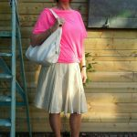 Pink T-shirt and a wide, silk skirt