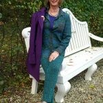 A green outfit and a purple coat
