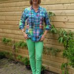 Checked blouse with skinny trousers