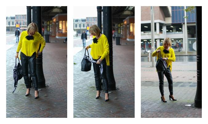 Adjusting Yellow Kenzo sweater
