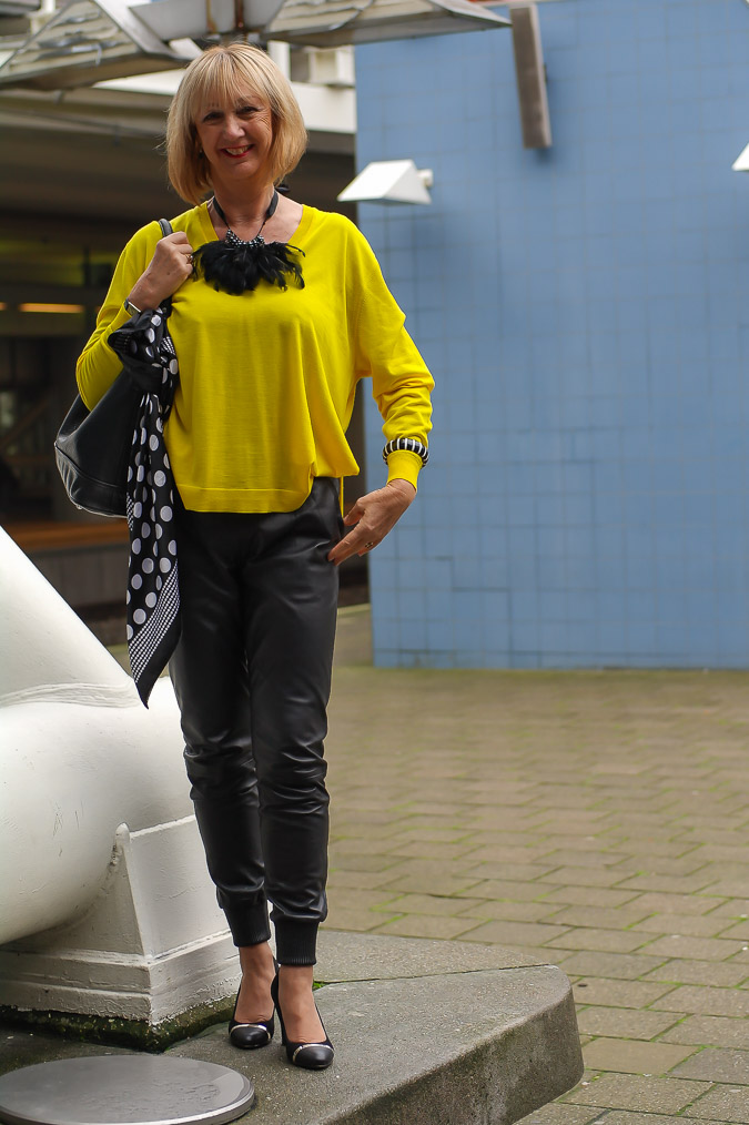 Yellow Kenzo sweater black leather trousers (15 van 20)