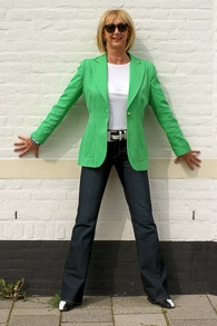 Flared jeans with Kermit green jacket