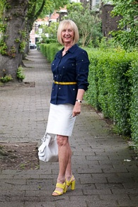 White pencil skirt, blue shirt with mirrors, yellow sandals