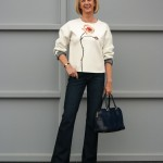 Flared jeans with flower sweater