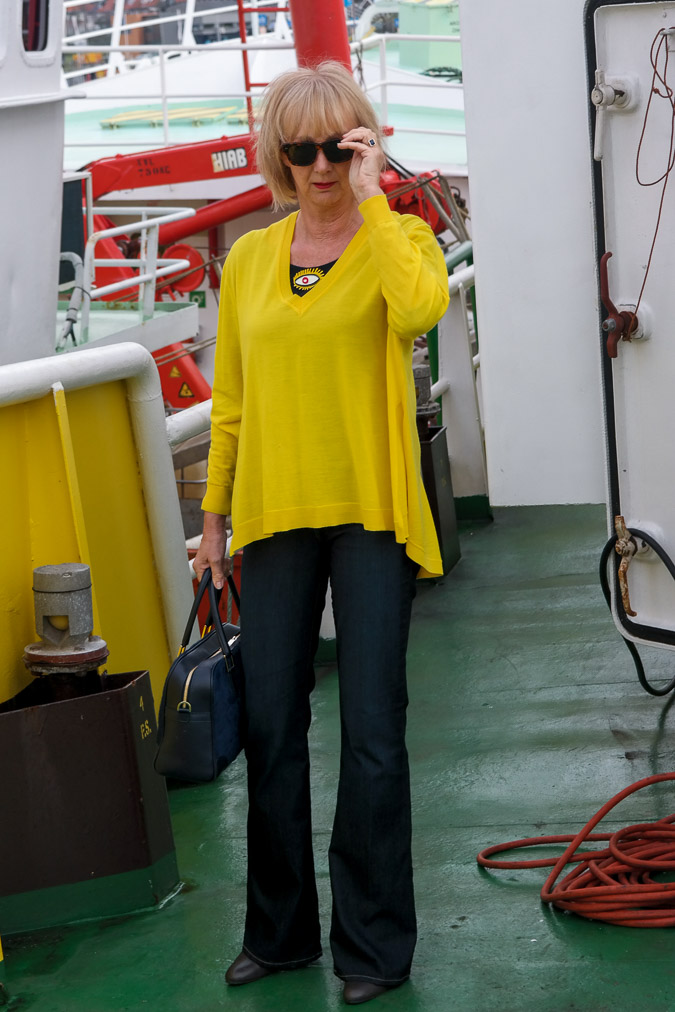 Flared jeans with yellow sweater