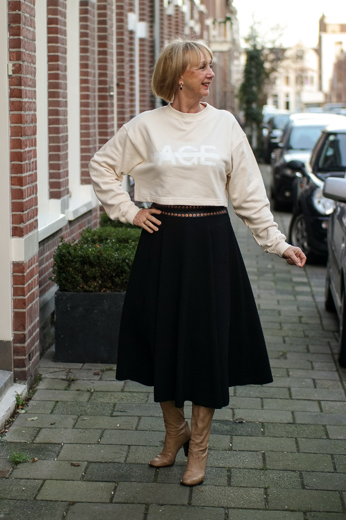 Long black circle skirt with cream cropped top