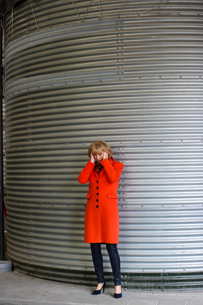 Orange coat by Claudia Sträter