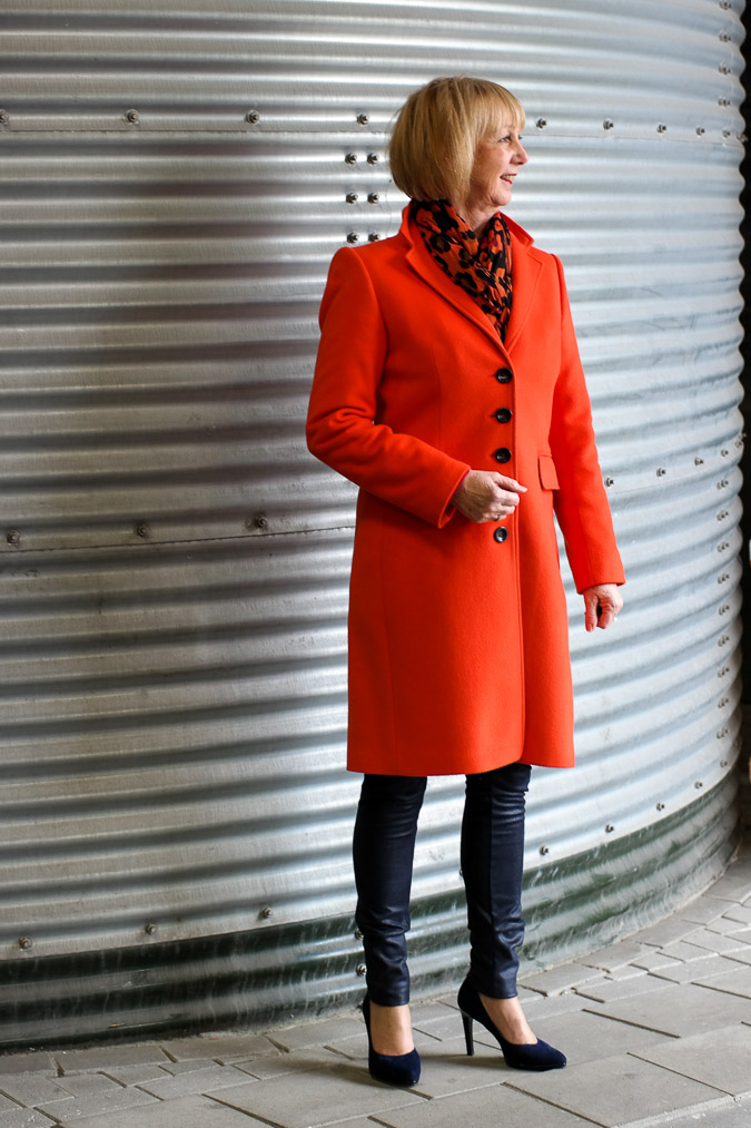 Orange coat by Claudia Sträter