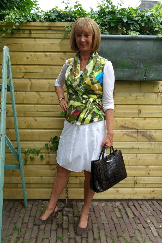 White skirt with leaf vest. Pauw.