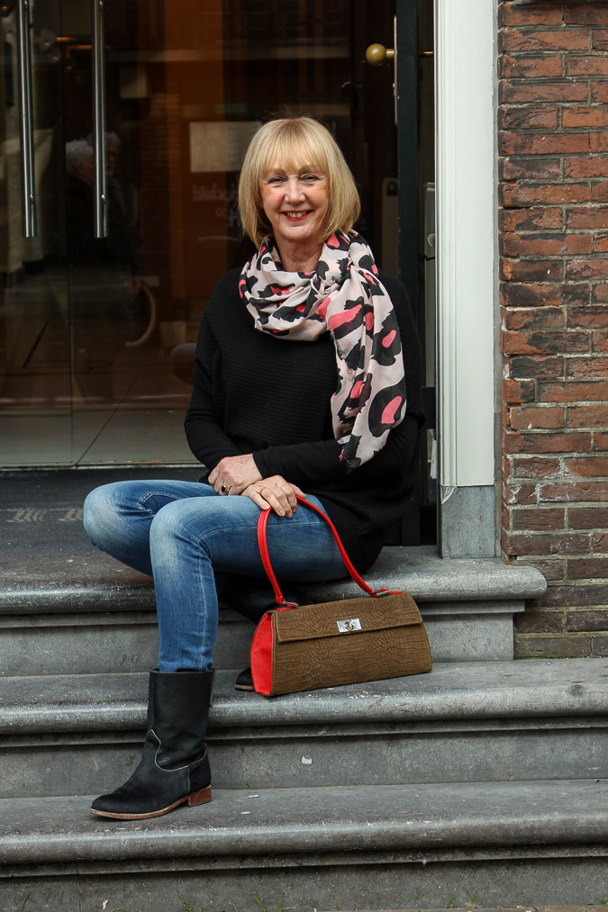 Pink, black and white scarf and a Marck&Co bag