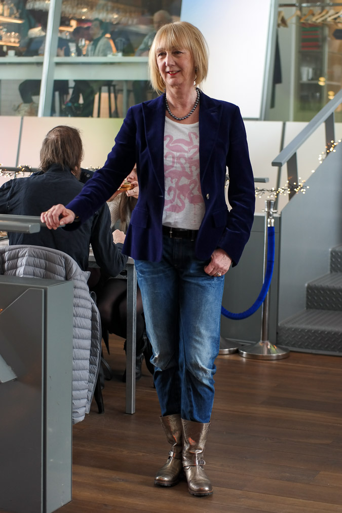 Distressed boyfriend jeans with a purple velvet jacket