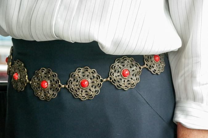 metal belt with red dots