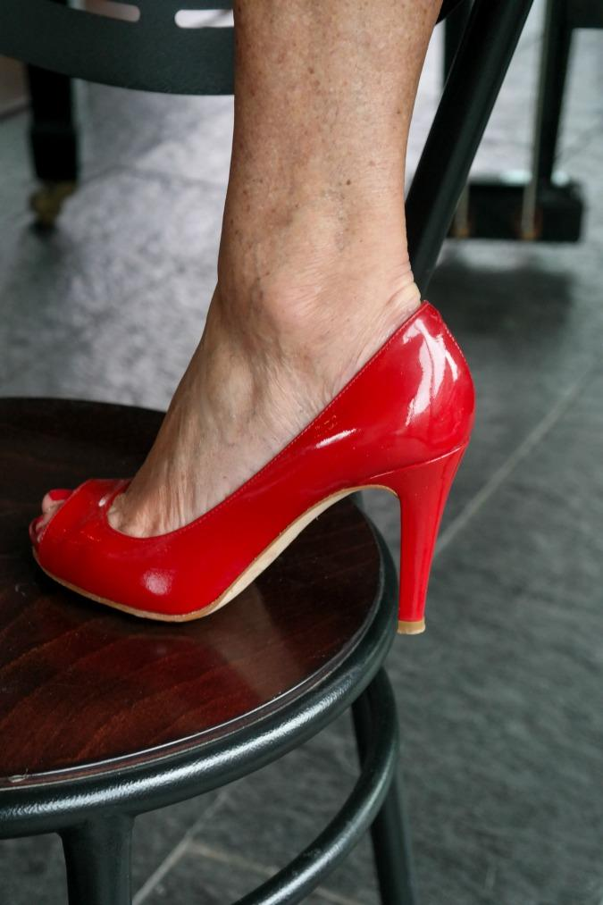 Red patent leather slingbacks