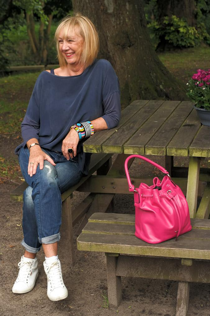 bangles, boyfriend jeans and a pink bag