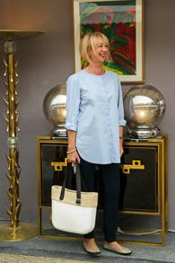 Baby blue high/low shirt and navy trousers by Bellamy Gallery