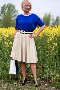 Bright blue top, camel pleated skirt and peeptoe shoes