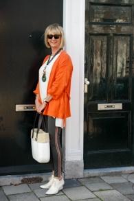 Orange jacket and leggings with side stripe