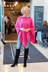 Over the knee boots and fuchsia poncho by Hope Fashion UK
