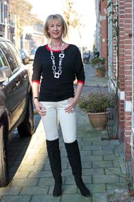Over the knee boots with cream jeans and black with red tops
