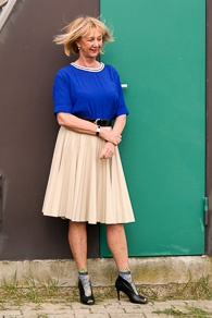 Bright blue top, camel pleated skirt and peeptoe pumps with socks