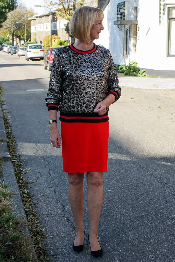 Sequined top with red pencil skirt