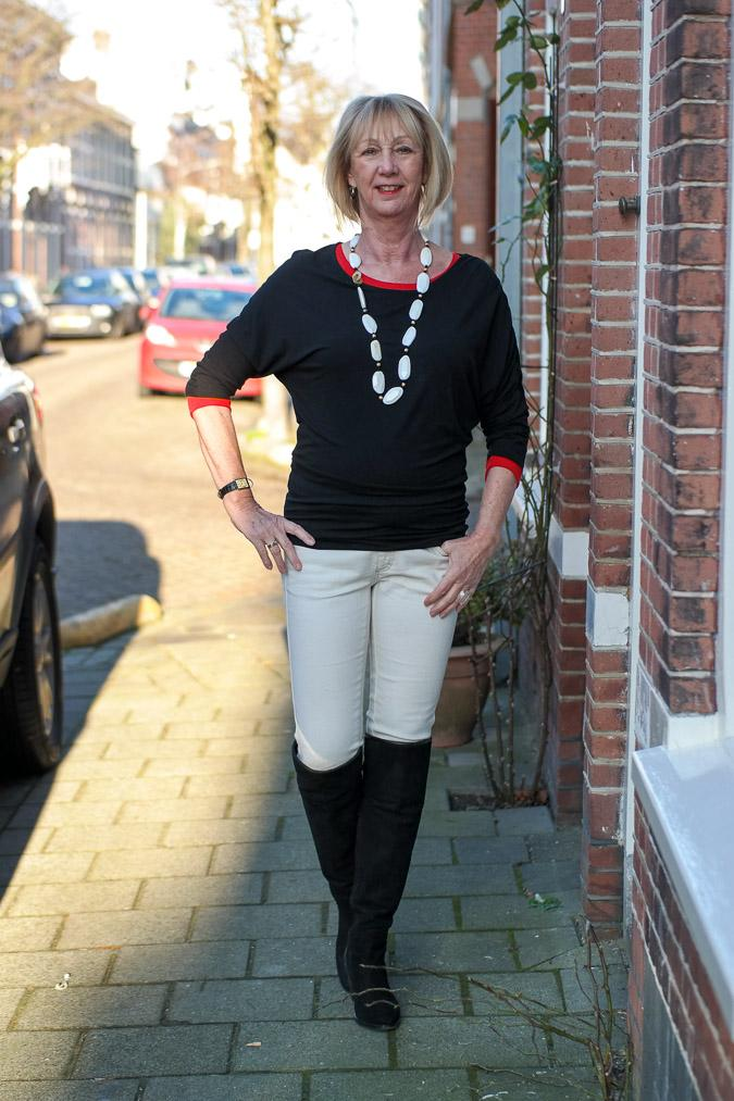Black, cream and red outfit with OTK boots