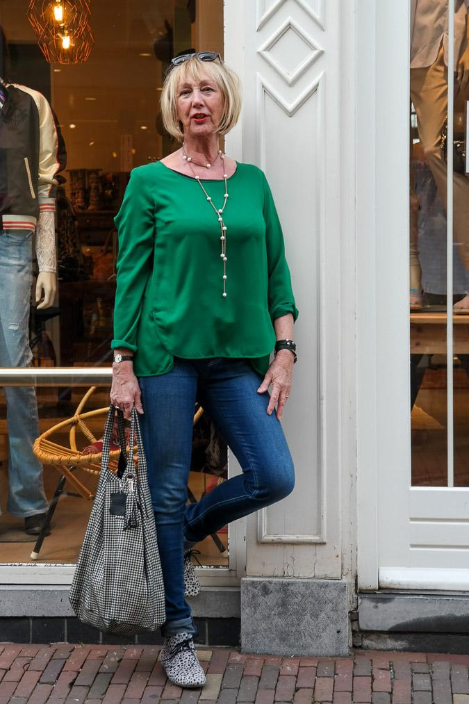 Green top, Denham jeans, black and white shoes and bag