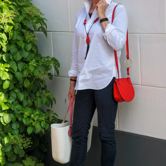 Eijk flat shoes and a red mini bag