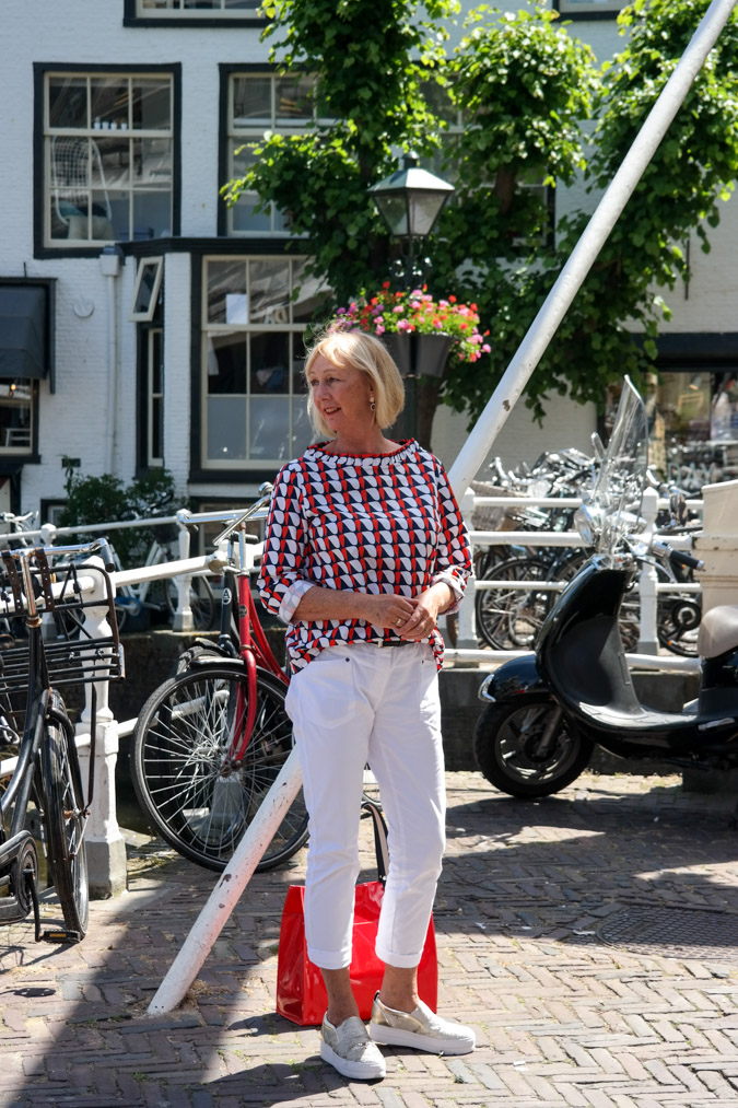 Top COS, trousers Corel, sneakers Essentiel