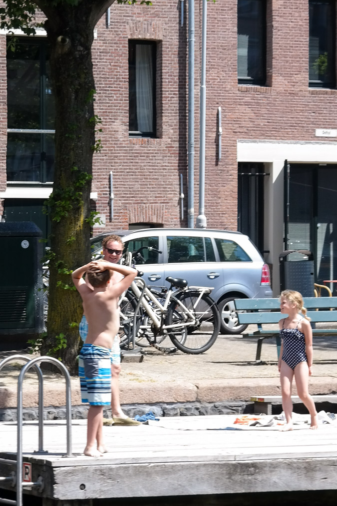 Cruising by boat through Amsterdam