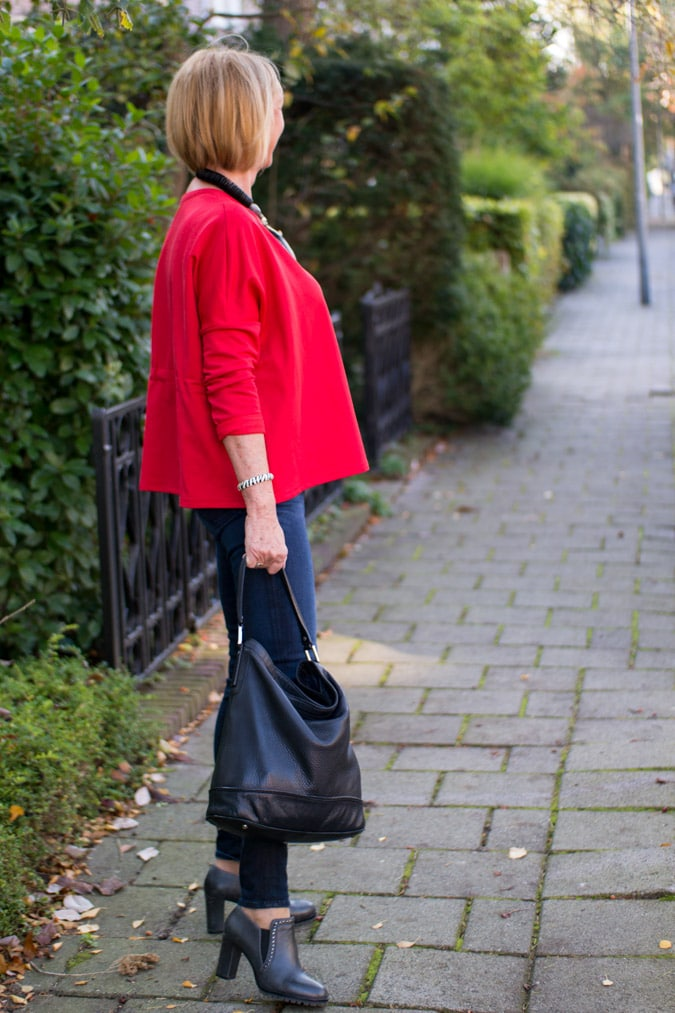 Red sweater and a green faux fur coat