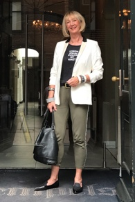 White tuxedo jacket with olive coloured jogging trousers with side stripe