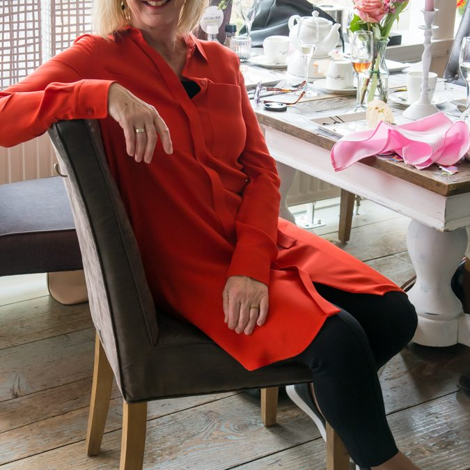Wearing a red Sportmax dress to Marianne's 70th birthday