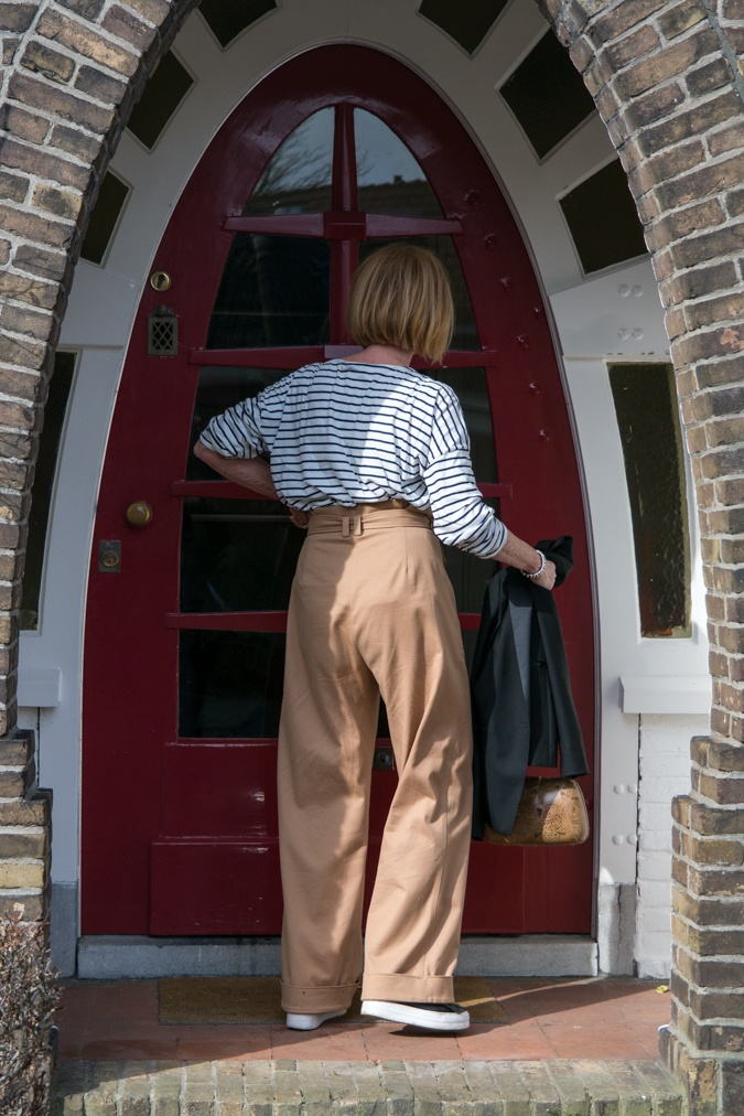 Wide khaki trousers with striped top