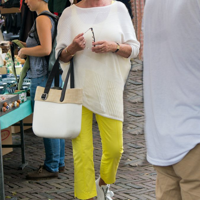 Lemon yellow trousers on the Noordermarkt
